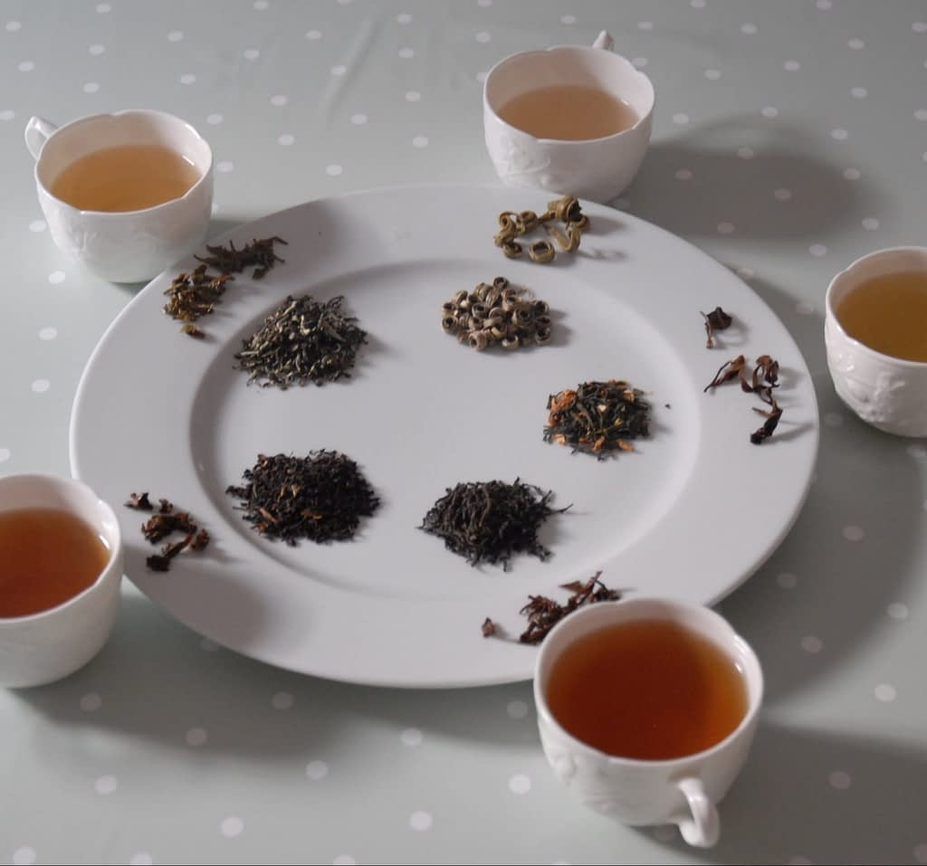 Assorted brewed tea leaves and liquor