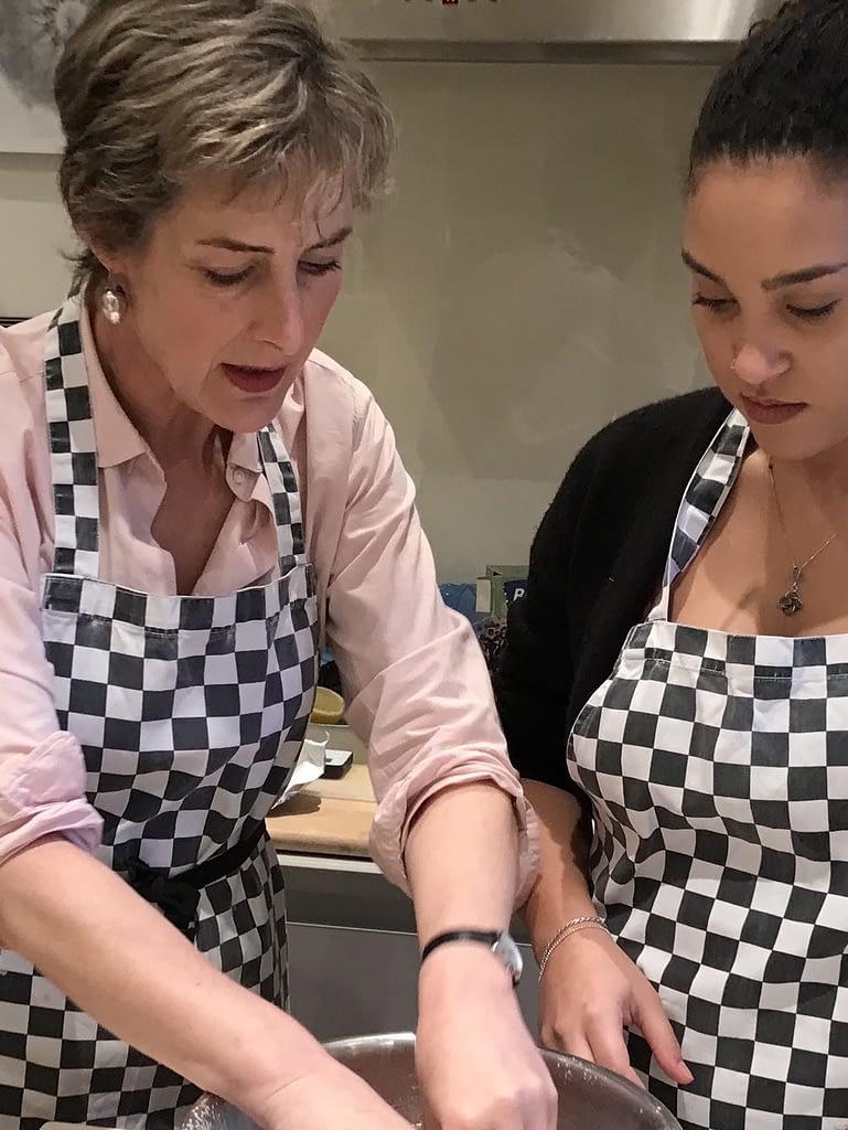 Caroline Hope helping student to make scones